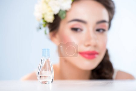 Woman looking at perfume