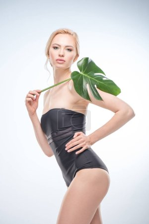 Young woman with green leaf