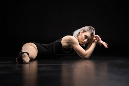 Young dancer stretching