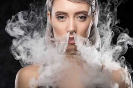 Woman in bodysuit with smoke