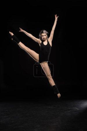 Dancing woman in bodysuit