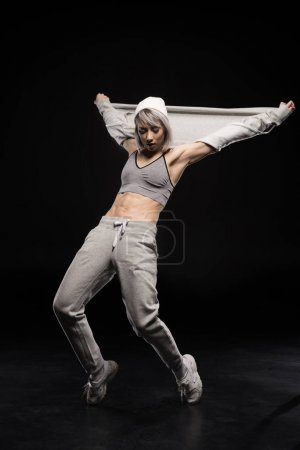 Dancing woman in sports clothing