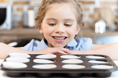 Girl and baking form