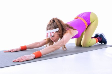 Sporty woman on mat