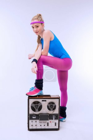 Woman with retro record player