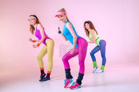 Sporty women doing exercises