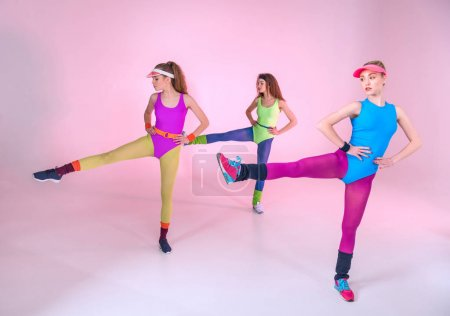 Sporty women doing exercises