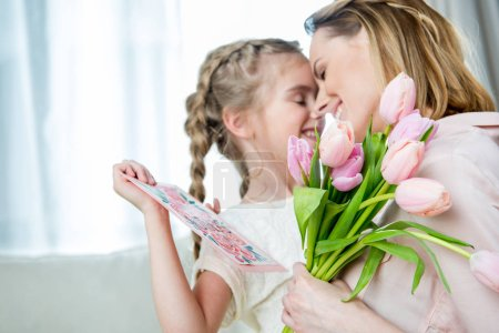 Daughter greeting mother