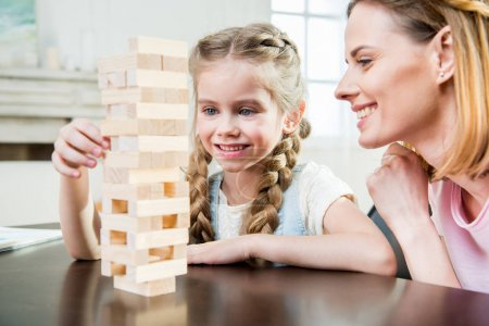 Mother and daughter playing jenga game