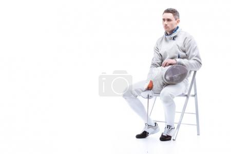 Young man professional fencer