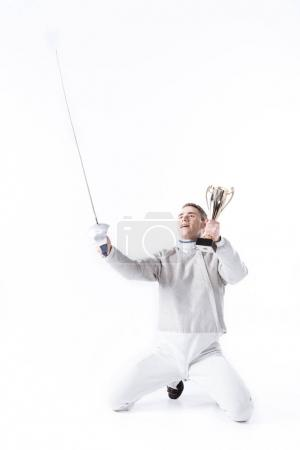 Fencer with champion's goblet