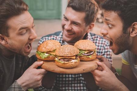 Men eating hamburgers