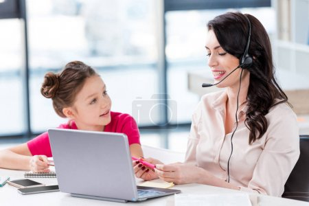 Mother and daughter at workplace