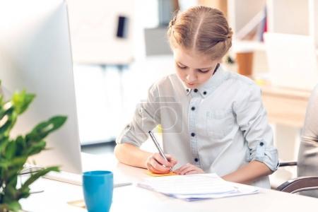 Little girl pretending to be businesswoman