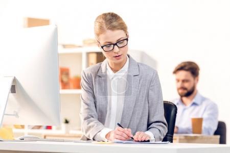 Businesswoman using computer