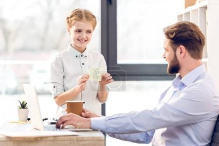 Businessman with daughter in office
