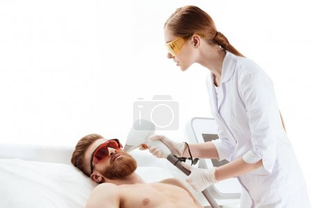 Man receiving laser skin care