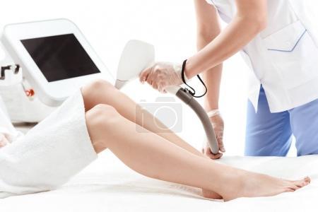 Woman receiving laser treatment