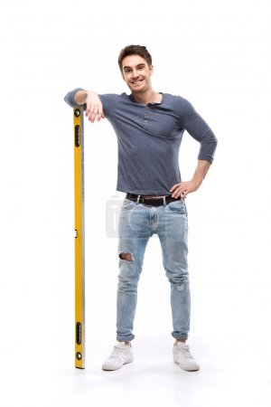 Man holding building level