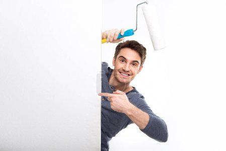 Man holding paint roller