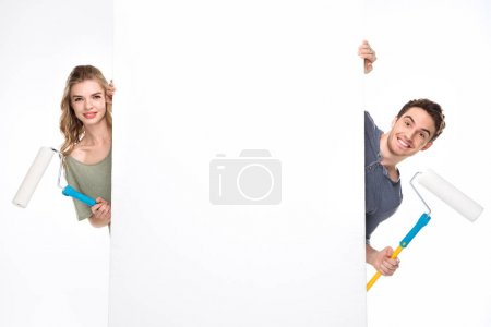 Couple with paint rollers and card