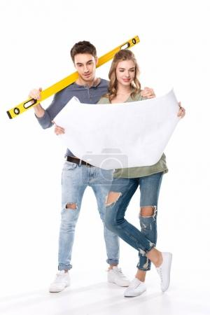 Young couple with blueprint