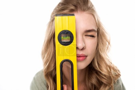 Young woman with level tool