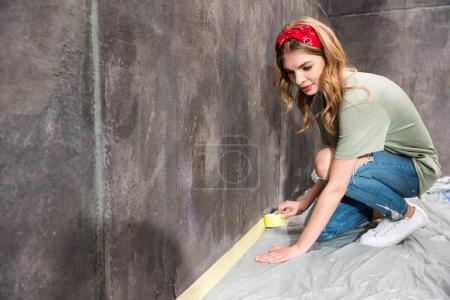Young woman renovating room