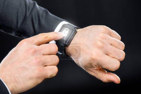 Businessman using smart watch
