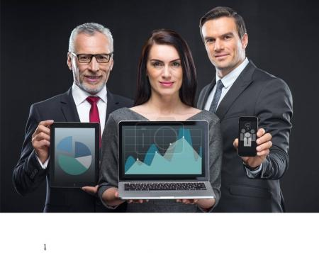 Business people holding digital devices