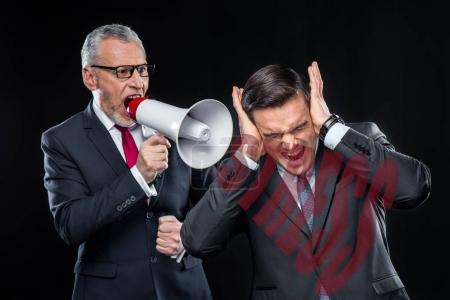 Boss with loudspeaker yelling on employee