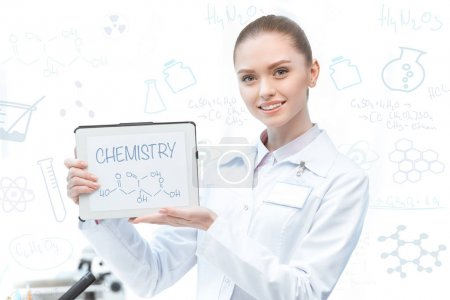 Woman scientist with digital tablet