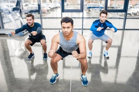 Men exercising at sports center