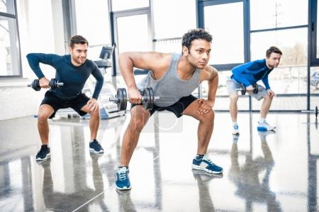Workout with dumbbells at gym