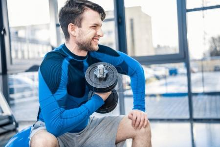 Man workout with dumbbell