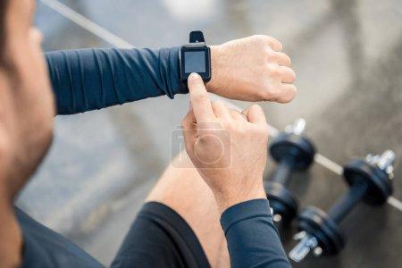 Man using  smartwatch at gym