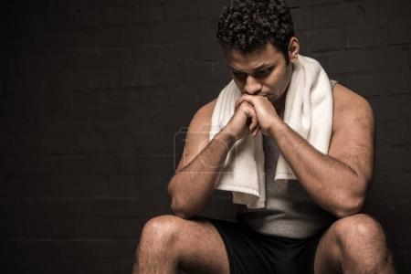 Man resting at locker room