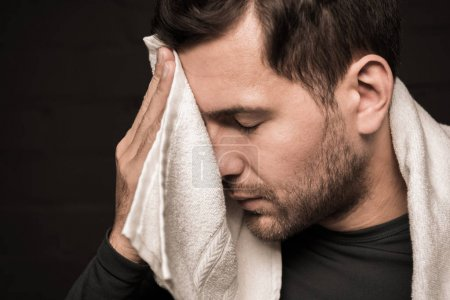 Sportsman wiping face