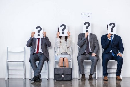 Businesspeople waiting for interview