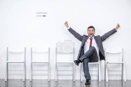 Excited businessman waiting for interview