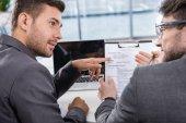 Successful businessmen on meeting