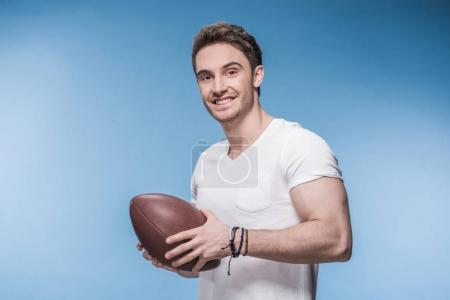 Young man with rugby ball