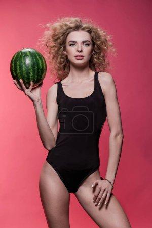 Woman holding fresh watermelon