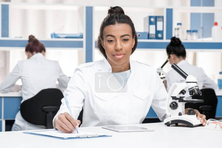 scientist working in chemical lab