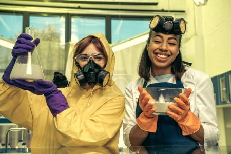Women holding containers with reagents