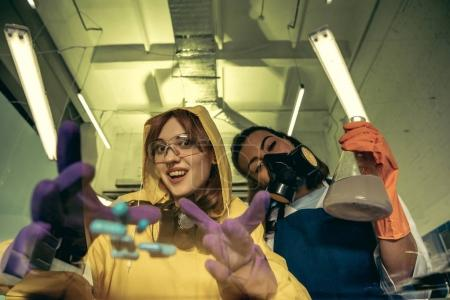 Women chemists at scientific laboratory with drugs