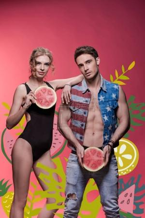 Couple holding watermelon pieces