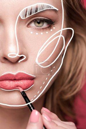 Woman doing makeup with lip brush