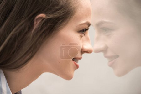 Young caucasian girl looking at reflection