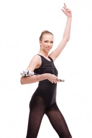 Rhythmic gymnast with clubs